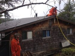 Here is a photo of the SEWFD ( the South Whiteshell Voluntary Fire Department) workers protecting the cottages that have been declared at immediate risk.